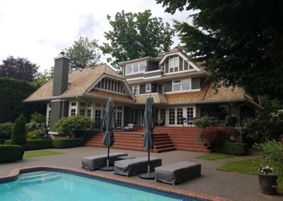 Window, roof, gutters and pressure washed concrete stone walkways to beautiful restored home in Victoria with pool.