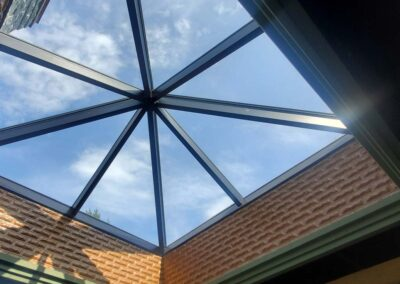 Cleaning hard to reach skylight window panes at commercial business